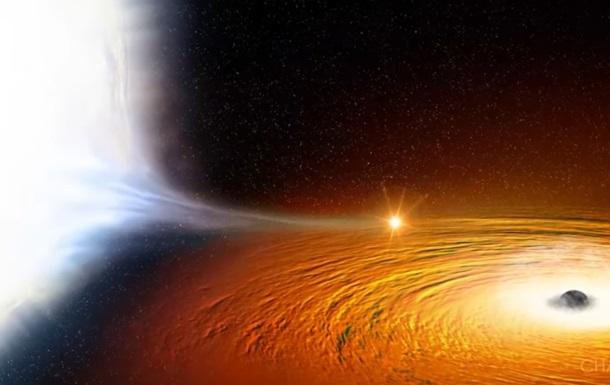 Ученые показали пожираемую черной дырой звезду