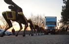 Роботы Boston Dynamics  буксировали  фуру