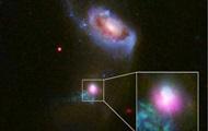 Hubble зняв поглинання галактики чорною дірою