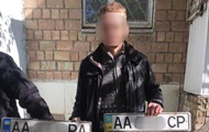 В Киеве мужчина украл 100 автомобильных номеров