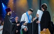 Боксер Усик получил орден от УПЦ МП
