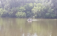Водолази підняли з річки автомобіль з трупом