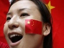 Олимпийский огонь в Гонконге: город оделся в красное
