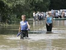 Число жертв стихии на западе страны достигло 26 человек