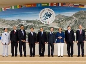 Участники саммита G-8 договорились в течение 40 лет сократить выбросы СО2 на 50%
