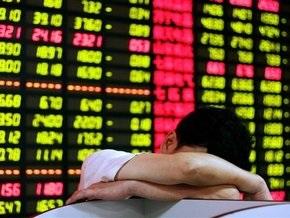 Обзор рынков: США закрылись пятилетним минимумом