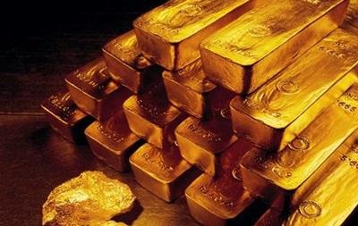 Цены на золото накаляются после слабеющего доллара