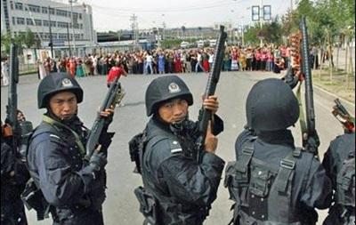 В Китае полиция застрелила 14 участников беспорядков