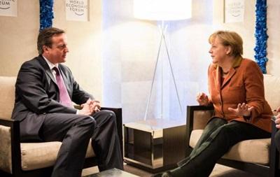 Кэмерон и Меркель обсудили  ужасную ситуацию на Украине