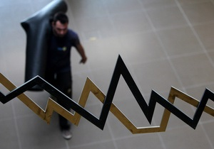 Рынки: Фондовые торговцы ведут себя осторожно