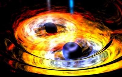 Две черные дыры  подрались  за звезду, а потом разорвали ее