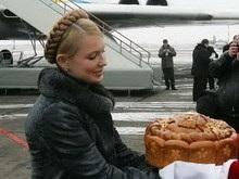 Тимошенко отбыла в Брюссель на женский слет