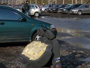Коммунальщики Киева не будут отвечать за затопленные авто на Троещине