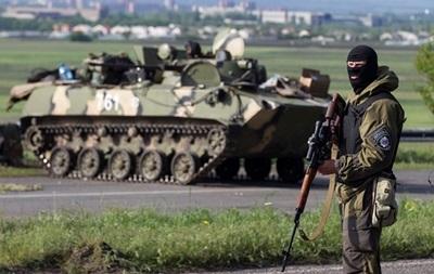 Силовики уничтожили пять единиц бронетехники, покидающих Славянск сепаратистов - СНБО
