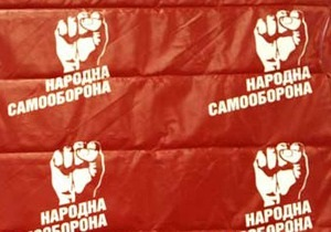 Самооборона: Активисту, расклеивающему плакаты СтопЗЕК, приставили пистолет к виску