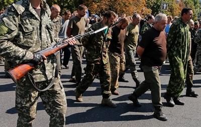 Опознаны около 20 участников  парада военнопленных  в Донецке