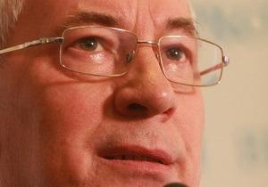 Азаров заявил, что достиг компромисса в переговорах с МВФ