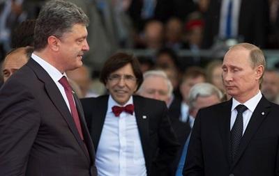 У Путина прокомментировали его телефонный разговор с Порошенко