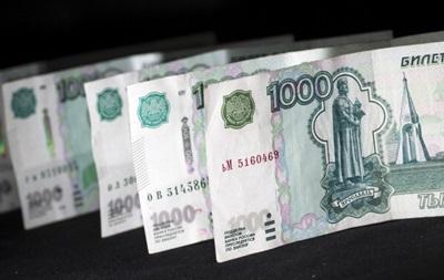 Рубль на відкритті торгів стрімко падає