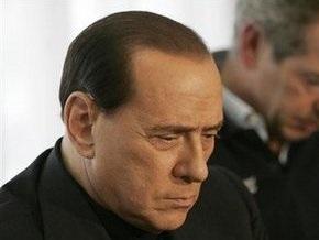 Берлускони: Италия пока не нуждается в помощи других стран