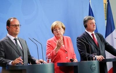 Порошенко в Берліні: звіряння годинників перед зустріччю з Путіним?