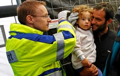 Германия продолжает принимать тысячи беженцев ежедневно