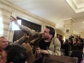 Иракский журналист, бросивший ботинок в Буша, вышел на свободу
