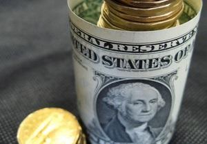 Доллар к евро упал до минимума шести недель на опасениях бюджетного обрыва
