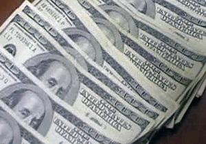 Эксперты: За три года доллар обесценился более чем вдвое