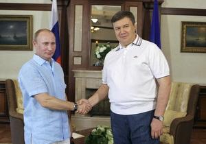Янукович поздравил Путина с новой должностью