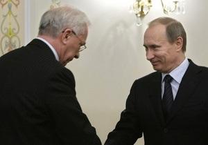 Азаров поздравил Путина