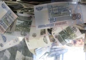 Рубль рекордно снизился к бивалютной корзине