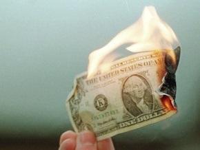 Доллар упал к иене до минимума более чем за 14 лет