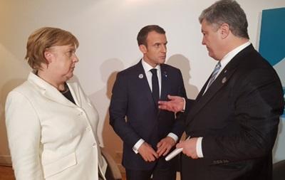 Порошенко, Меркель и Макрон обсуждают  выборы  в  ЛДНР