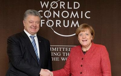 Порошенко начал переговоры с Меркель
