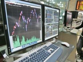 Рынки: укрепление доллара давит на биржи