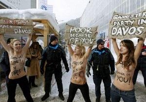 В Давосе активистки FEMEN провели акцию Стоп давосский заговор!
