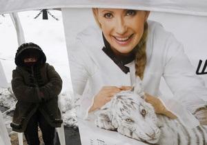 РИА Новости: Белый тигр не принес удачи  даме с косой  на выборах в Украине