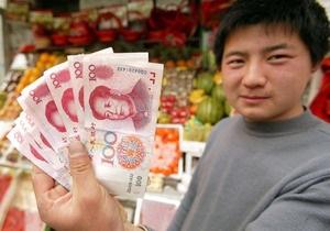 Китай просит США не вмешиваться в валютную политику страны