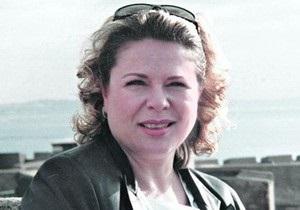 Сегодня прилетела домой из Ливии  украинская медсестра  Каддафи
