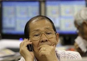 Азиатские акции рухнули после отчетов в США