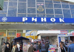 В Полтаве грузчики рынка помогли поймать грабителя банка