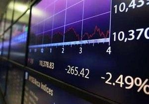Dow Jones понизился ниже психологически важного рубежа в 10000 пунктов