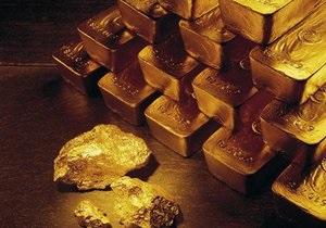 Цена на золото рухнула до трехнедельного минимума