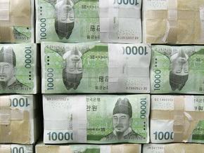 Банк Японии купит у банков акции на $111 млрд