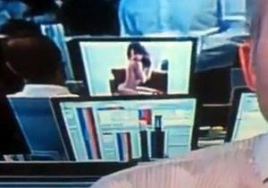В Австралии банкира поймали на просмотре фото голых моделей в прямом эфире
