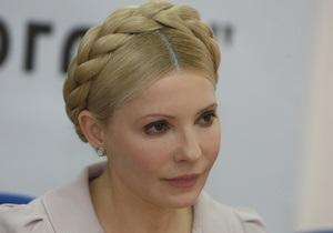 Тимошенко: Член ПР тихо заталкивал в бак для мусора флаг своей партии