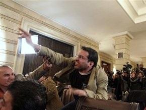 Иракский журналист извинился перед Бушем за брошенные ботинки