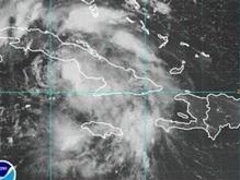 На Гаити шторм смыл автобус в реку: около 50 человек погибли