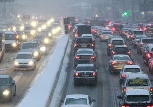 Фотогалерея: Стой, снег идет! Интенсивный снегопад парализовал движение в Москве